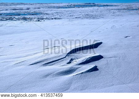 Field In The Evening In Winter After Snow Drifts. Russia