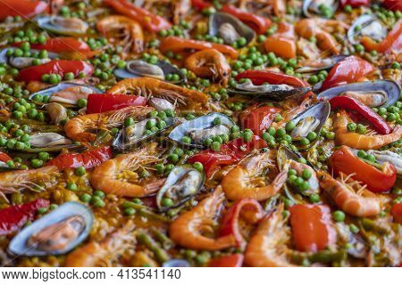 Spanish Seafood Paella In Fry Pan With Mussels, Shrimps And Vegetables. Seafood Paella Background, C