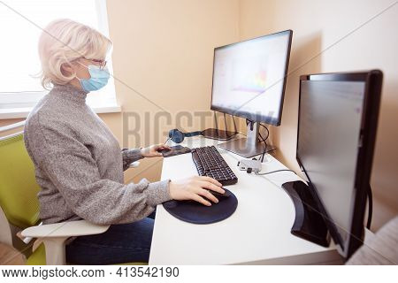 Woman Working At Home In Homeoffice. Young Businesswoman Sitting Indoors And Using Pc