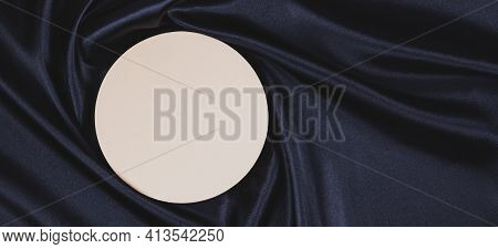 Pastel Circle Platform Podium On Black Color Background With Drapery And Wavy Folds Of Silk Satin Ma