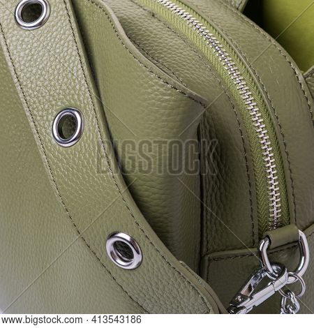 Close Up Of Details Of Bag For Women, Made Of Genuine Grained Olive-colored Leather. Handle With Gro
