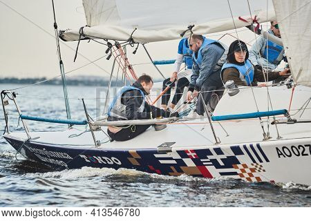 Russia, St.petersburg, 05 September 2020: Participants Of A Sailing Regatta On The Sailboat, Pull Ro
