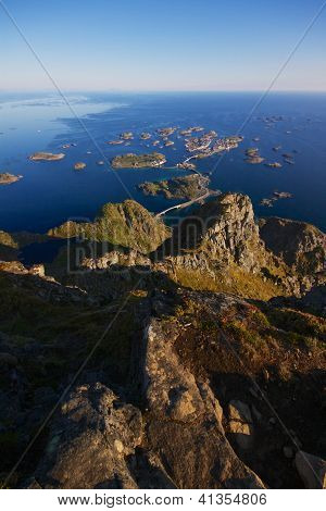 Scenic town of Henningsvaer on Lofoten islands in Norway with bridges connecting rocky islands poster