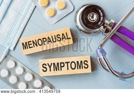 Menopausal Symptoms Written On Wooden Cubes On Medical Background.