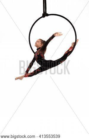 Aerial Acrobat Performing Trick On Hula Hoop