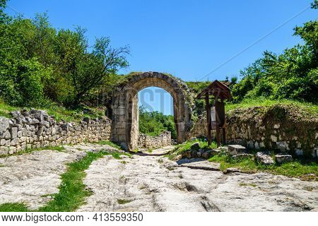 Inner Gates Inside Ancient City-fortress Chufut Kale, Bakhchisaray, Crimea. Bricks On Both Side Of S