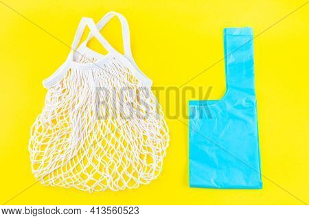 Mesh Bag Vs Plastic Bag On A Yellow Background, Zero Waste Or Plastic Free Concept, Horizontal, Top