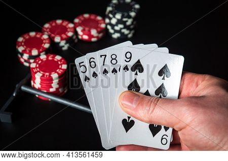 Poker Cards With Straight Flush Combination. Close Up Of A Gambler Hand Is Holding Playing Cards In
