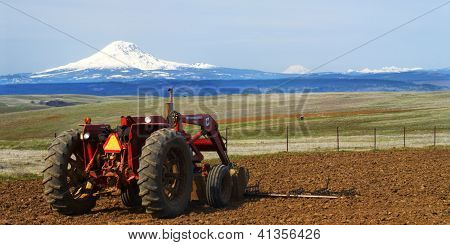 Tractor In Front Of Mount Adams