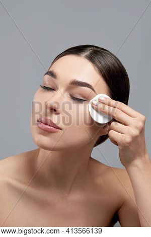 Woman Cleaning Face With Pad.beautiful Girl Removing Makeup With White Cosmetic Cotton Pad. Female T