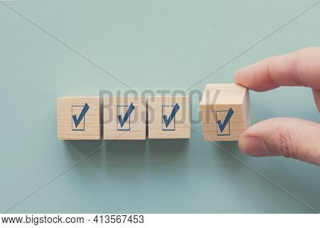 Hand Holding Wooden Block With Tick Mark, Good Feedback Rating And Positive Customer Review, Experie
