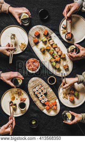 Flat-lay Of People Eating Various Sushi During Japanese Lockdown Dinner