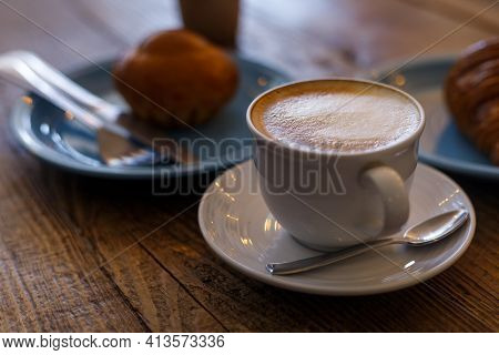 Close Up Hot Cappuccino, Latte On Table With Blur Coffee Shop Background. Hot Cappuccino Coffee On W