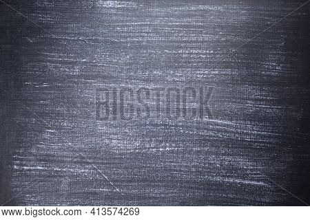 Painted canvas background texture as abstract wall surface. Painted dark grey or black background canvas