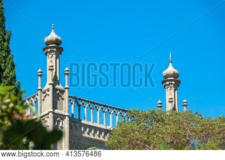 The Walls Of The Old Palace On The Background Of A Blue Sky. Vorontsov Palace, Or The Alupka Palace