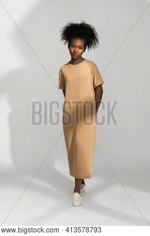 African American woman in brown t-shirt dress teen's for apparel shoot