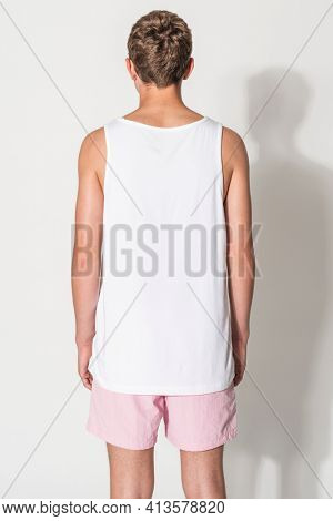 Men's white tank top and pink shorts for teen's summer apparel shoot with design space