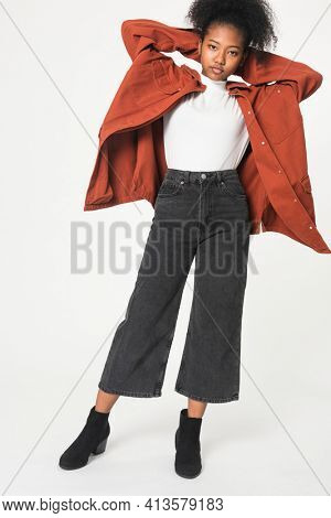 African American girl in orange oversized jacket for youth apparel shoot