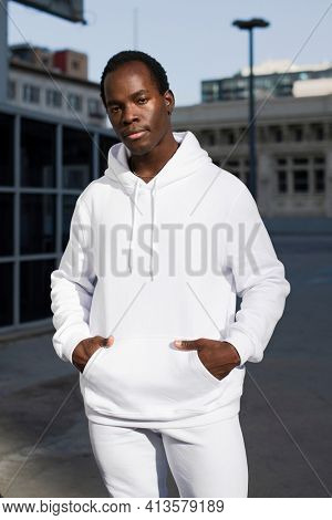 Man in white hoodie sporty menswear