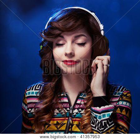 Girl with headphones enjoying music