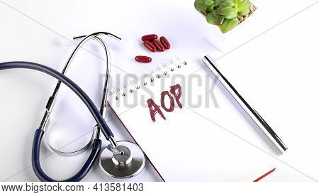 Text Aop On A White Background With Pills And Stethoscope. Medical