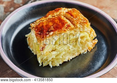 Slice Of Potato Pie With Onions, Ready After Baking On Black Plate. Step By Step Recipe