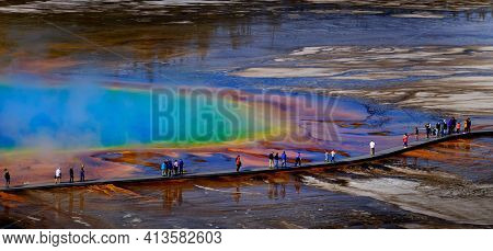 Grand Prismatic Spring in Yellowstone National Park with steam rising