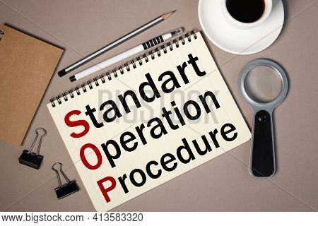 Sop As Standard Operating Procedure. Text On White Paper On Brown Background
