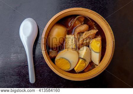 Stewed Boiled Egg With Tofu And Streaky Pork In Chinese Brown Soup