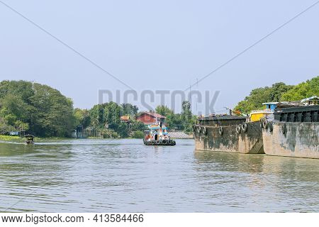 Scenery On Both Sides Of The Chao Phraya River And A Towing Boat In Ayutthaya Province In Thailand.