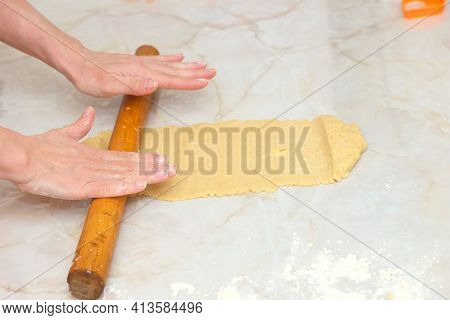 Woman Hands Rolling Out Dough With Rolling Pin