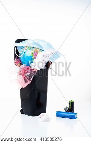 Trash Can With A Globe And Rubbish. Overflowing Trash Can. Pollution Of The Planet. Vertical Frame.