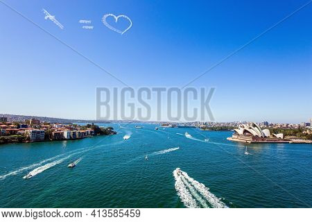 Funny airplane trail in the sky over Sydney port. Australia. The famous Sydney Harbor. Boat trip on a tourist boat