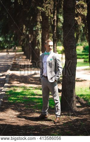 Groom At Wedding Tuxedo Smiling And Waiting For Bride. Rich Groom At Wedding Day. Elegant Groom In C