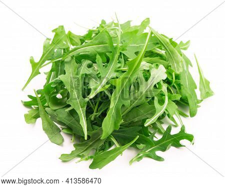 Green Fresh Rucola Or Arugula Leaf Isolated On White Background.