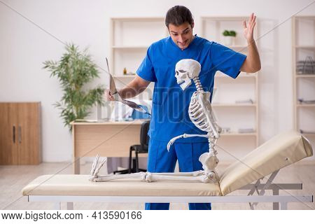 Young male doctor radiologist and skeleton patient in the clinic