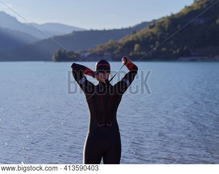 triathlete swimmer portrait wearing wetsuit on training