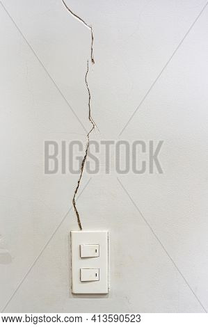 White Wall With Severe Cracked Groove Near The Light Switch