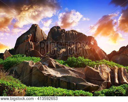 Big granite rocks close to Anse Songe beach at sunrise. La Digue Island, Indian ocean, Seychelles.