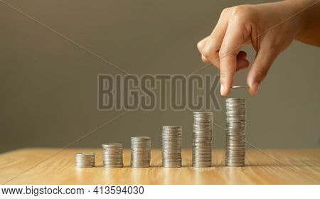 Woman's Hand. Place A Coin On The Coin Graph With Coins, Saving Money With Coins, Stepping Into A Su