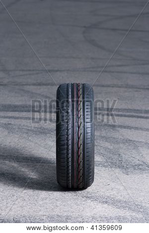 New car tire on drift pattern road poster