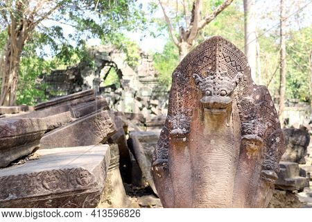 Ancient statues of multi-headed serpents or nagas and ruin of Koh Ker complex, Cambodia, Indochina. UNESCO world heritage site