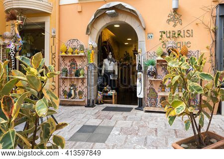 Taormina, Italy - March 4, 2020: Colorful boutique shop in Sicily, Italy.