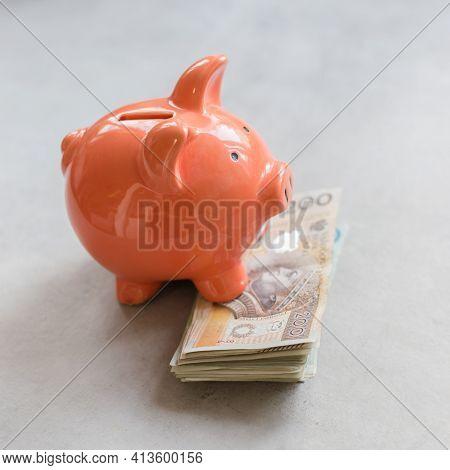 Piggy Bank With Polish Money On Concrete Table - Saving Profit Concept