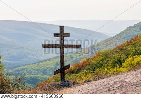 Orthodox Christian Bow Cross Monument On Slope Of Mangup-kale Which Is Ancient Cave Town In Crimea.
