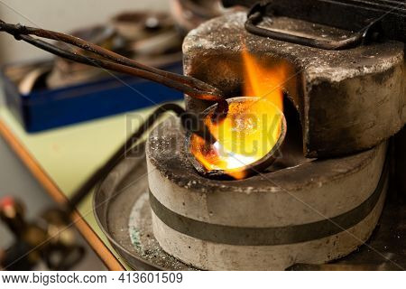 Blowtorch Melts Silver In A Jewelry Workshop Furnace