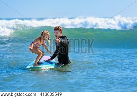 Little Surf Girl - Young Surfer Learn To Ride On Surfboard With Instructor At Surfing School. Active