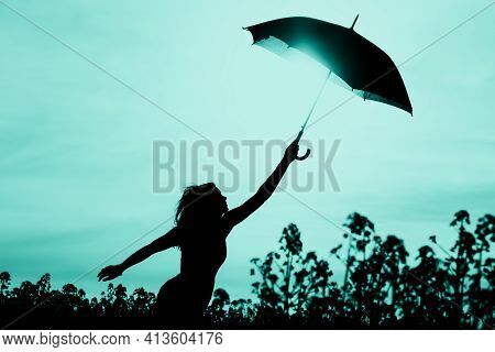 Unplugged Free Silhouette Woman Has Umbrella Up To Turquoise Sky. Nature Girl At Windy Rainy Day Has