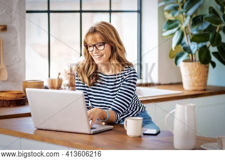 Shot Of Middle Aged Businesswoman Having Video Call While Working From Home