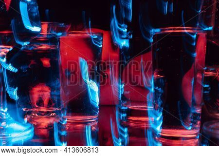 Psychedelic Strange Portrait Of A Man Looking Through Glasses Of Water With Blur
